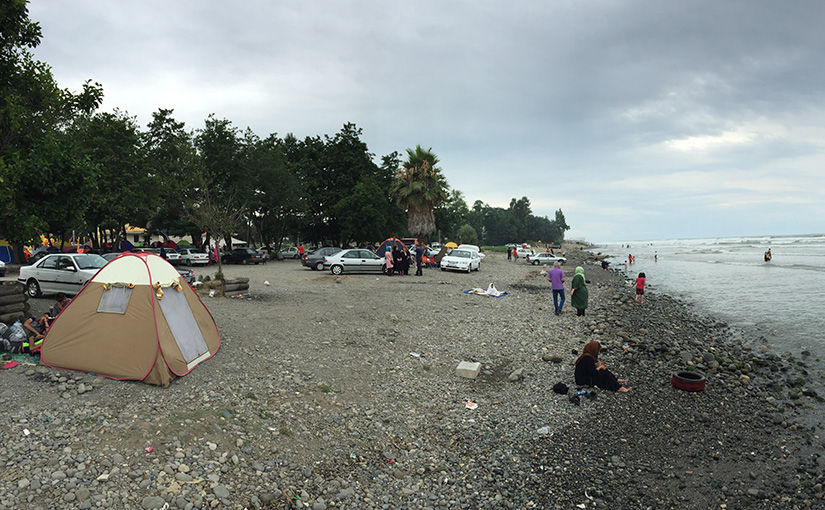 Crowds of people on a picnic at the Caspian Sea