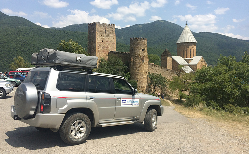 Our car in front of the Ananuri Monastery